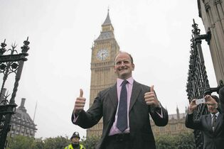 The Associated PressNewly elected U.K. Independence Party MP Douglas Carswell gives the thumbs-up upon his arrival to take his seat at the Houses of Parliament last week. The U.K. Independence Party won a seat in the British Parliament for the first time.