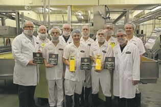 The Bothwell Cheese team says cheese with their awards. Front row (from left): Rob Hiebert, Eddy Doerksen, Phil Dupuis,  David Ray and Kevin Thomson. Back row (front left): Gil Dueck, Nathan Dueck, Alex Neufeld, Ernie Falk and Levi Falk.