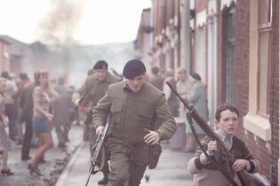 Jack O'Connell as Pte. Hook, a British solider during the Troubles.