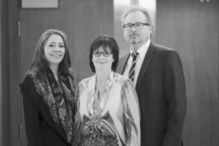 Economic Development Winnipeg CEO Marina James is flanked by co-chairs Mary Jane Loustel and Michael Scatliff.