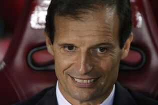 Juventus' coach Massimiliano Allegri smiles before the Group A Champions League soccer match between Atletico De Madrid and Juventus at the Vicente Calderon stadium in Madrid, Spain, Wednesday, Oct. 1, 2014. (AP Photo/Daniel Ochoa de Olza)
