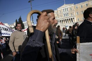 Farmers take part in a protest outside the Greek parliament against government tax policies in central Athens on Wednesday, Feb. 19, 2014. About 4,000 people, including civil servant unions, took part in the peaceful demonstration outside the House of Parliament. Greece's conservative-led government has committed to continue spending cuts and economic reforms in exchange for billions of euros in international rescue loans. (AP Photo/Petros Giannakouris)