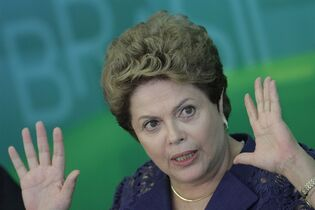 Brazil's President Dilma Rousseff speaks during a press conference at the Planalto Presidential Palace, in Brasilia, Brazil, Monday, Dec. 22, 2014. President Rousseff gave one of her last press conferences before the Christmas holiday and talked about various topics, including the recent Petrobras scandal. (AP Photo/Eraldo Peres)