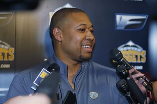 Newly named Denver Nuggets interim coach Melvin Hunt talks to reporters in his first news conference, before the Nuggets' NBA basketball game against the Milwaukee Bucks on Tuesday, March 3, 2015, in Denver. The Nuggets fired Brian Shaw on Tuesday (AP Photo/David Zalubowski)