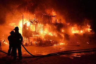 Fire engulfs a seniors residence in L'Isle-Verte, Que., in this early Thursday, Jan. 23, 2014 file photo. THE CANADIAN PRESS/Frances Drouin