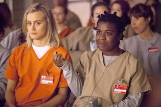 Taylor Schilling and Uzo Aduba are pictured in a scene of the Netflix series'