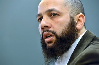 Adil Charkaoui speaks about the suspension of two contracts with junior colleges at a news conference in Montreal on Friday, February 27, 2015. A Montreal junior college is cutting ties with Charkaoui, an Islamic educator who was once considered a terrorist suspect by the federal government. THE CANADIAN PRESS/Paul Chiasson