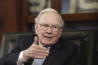 Berkshire Hathaway Chairman and CEO Warren Buffett gestures during an interview with Liz Claman on the Fox Business Network in Omaha, Neb, May 5, 2014. Buffett says he would have approved the Keystone XL project, designed to move oilsands bitumen from Alberta to refineries on the Gulf Coast.THE CANADIAN PRESS/AP/Nati Harnik