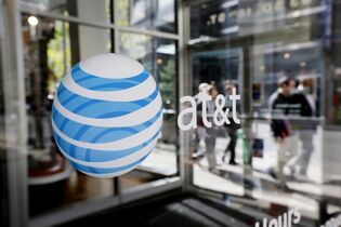An AT&T logo is displayed on an AT&T Wireless retail store front, in Philadelphia, on Oct. 17, 2012. THE CANADIAN PRESS/AP, Matt Rourke