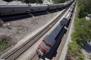 Two CN trains pass a rail intersection in North Vancouver, on May 10, 2012. THE CANADIAN PRESS/Jonathan Hayward