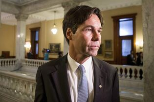 Health Minister Eric Hoskins is pictured at Queens Park in Toronto on June 24, 2014. THE CANADIAN PRESS/Chris Young