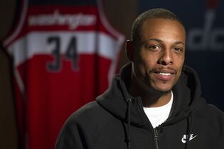 In this Oct. 16, 2014, photo, Washington Wizards NBA basketball player Paul Pierce is interviewed at the Verizon Center in Washington. When Pierce watched the Wizards in last season's playoffs, he saw plenty of talent and potential. He also saw some issues. They needed something. Turns out, Pierce thought they needed ... him. (AP Photo/Cliff Owen)