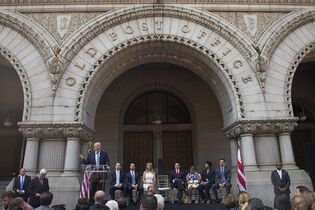 Donald Trump delivers remarks during a ground breaking ceremony for the Trump International Hotel on the site of the Old Post Office, on Wednesday, July 23, 2014, in Washington. (AP Photo)