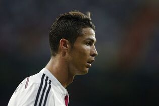 Real Madrid's Cristiano Ronaldo reacts during a Spanish Super Cup soccer match against Atletico Madrid at Santiago Bernabeu stadium in Madrid, Spain, Tuesday, Aug. 19, 2014 . (AP Photo/Daniel Ochoa de Olza)
