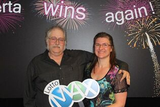 William and Andrea Groner pose at the Western Canada Lottery Corporation in Edmonton, Tuesday, July 22, 2014. The Groners managed to keep their lottery windfall in the immediate family for seven months. But the Edmonton couple's exciting news is now out - they are the mystery winners of the $50-million Lotto Max jackpot from Dec. 20. THE CANADIAN PRESS/HO-WCLC