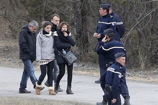 Family members of people involved in the Germanwings jetliner that crashed on Tuesday in the French Alps leave after a gathering in Le Vernet, France, Thursday, March 26, 2015. French prosecutors' assertion that this week's air crash of a German airliner into a rugged mountainside was a deliberate act of the co-pilot points to the possible need for a third pilot in airline cockpits, several aviation safety experts said Thursday. (AP Photo/Christophe Ena)