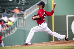 Boston Red Sox's Clay Bucholz pitches against Northeastern during a spring training exhibition baseball game, Tuesday, March 3, 2015, in Fort Myers, Fla. (AP Photo/The News-Press, Andrew West) MAGS OUT; NAPLES OUT; NO SALES