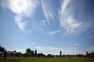 With clouds above, Julieta Granada of Paraguay putts on the 17th hole as, from left, Christina Kim and Pornanong Phatlum of Thailand wait their turn Thursday, Nov. 20, 2014 at the Tiburon Golf Club at the Ritz-Carlton Golf Resort in Naples, Fla. A field of 69 female golfers teed off in the first round of the LPGA'S CME Group Tour Championship. Julieta Granada of Paraguay lead the day with -6 under par and Sandra Gal of Germany in second at -4 under par. (AP Photo/Naples Daily News, Corey Perrine)