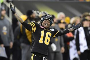 Hamilton Tiger-Cats wide receiver Brandon Banks celebrates on the sidelines during second half action against the Montreal Alouettes in the CFL Eastern Division final in Hamilton, Ont., on Sunday, Nov. 23, 2014. THE CANADIAN PRESS/Frank Gunn