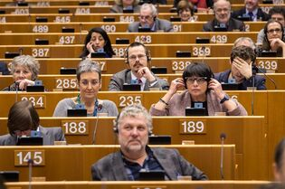 Members of European Parliament arrive to discuss anti-terrorism measures during a plenary session at the European Parliament in Brussels on Wednesday, Jan. 28, 2015. (AP Photo/Geert Vanden Wijngaert)