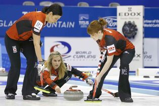 Canada's skip Jennifer Jones, center, watches after releasing the rock as the team plays Russia during the fourth end of semi-final of the women's World Curling Championships on Saturday in Sapporo, northern Japan. Canada won 7-4, putting the team in the final on Sunday against Switzerland.