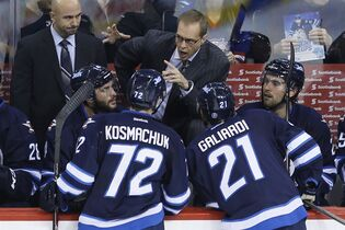 Winnipeg Jets' head coach Paul Maurice talk to his team in a timeout during first period NHL pre-season action in Winnipeg on Wednesday, September 24, 2014. THE CANADIAN PRESS/John Woods