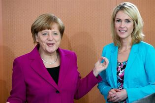 FILE - In this June 4, 2014 file photo German Chancellor Angela Merkel and Minister for Family Affairs Manuela Schwesig, from left, attend a cabinet meeting at the chancellery in Berlin, Germany. Germany's Parliament has approved a quota system that will require leading companies in Europe's biggest economy to have at least 30 percent women on their supervisory boards starting next year. Lawmakers from Merkel's governing coalition backed the legislation Friday, March 6, 2015, while opposition lawmakers who argued that it didn't go far enough abstained. (AP Photo/dpa, Maurizio Gambarini, File)