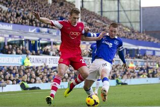 "FILE - This is a Sunday Dec. 29, 2013 file photo of Southampton's Calum Chambers as he fights for the ball against Everton's James McCarthy,during their English Premier League soccer match at Goodison Park Stadium, Liverpool, England. English Premier League team Arsenal has signed defender Calum Chambers from Southampton for an undisclosed fee . The 19-year-old Chambers has penned a ""long-term"" contract at Arsenal, according to the North London club on Monday July 28, 2014. (AP Photo/Jon Super, File)"
