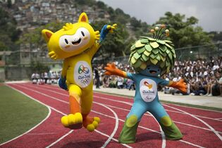 FILE - This is a Monday, Nov. 24, 2014 file photo of the mascots of the Rio 2016 Olympics, left, and Paralympic Games make their first official appearance at a public school in the Santa Teresa neighborhood of Rio de Janeiro, Brazil. The mascot for the 2016 Olympics in Rio de Janeiro has been named as Vinicius, left, and the Paralympics mascot will go by the name of Tom it was announced Monday Dec. 15, 2014. The names honor Brazilian musicians and partners Vinicius de Moraes and Tom Jobim. They were exponents of Bossa Nova music and creators of the famous song