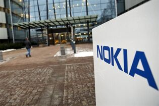 FILE - This Thursday, Jan. 29, 2015 shows the Nokia head offices in Espoo, Finland. Nokia says it is in advanced discussions to acquire the French telecommunications company Alcatel-Lucent. In a brief statement Tuesday, the Helsinki-based mobile technology concern said the two companies are in advanced negotiations