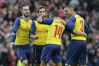 Arsenal's Theo Walcott, second right, celebrates after scoring a goal during the English FA Cup 4th round soccer match between Brighton & Hove Albion and Arsenal at the Amex Stadium, Brighton, England, Sunday, Jan. 25, 2015. (AP Photo/Tim Ireland)
