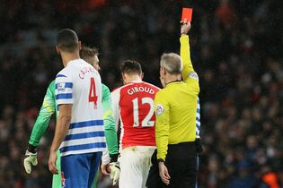 Arsenal's Oliver Giroud is sent off during the English Premier League soccer match between Arsenal and Queens Park Rangers at the Emirates Stadium, London, Friday, Dec. 26, 2014. (AP Photo/Tim Ireland)