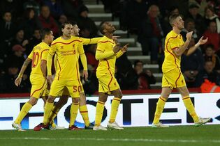 Liverpool's Raheem Sterling, center, celebrates with teammates after scoring a goal during the English League Cup soccer quarterfinal match between AFC Bournemouth and Liverpool at Goldsands Stadium, Bournemouth, England, Wednesday, Dec. 17, 2014. (AP Photo/Tim Ireland)