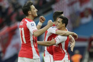 Arsenal's Alexis Sanchez, right, celebrates after scoring a goal during the English FA Cup semifinal soccer match between Arsenal and Reading at Wembley Stadium in London, Saturday, April 18, 2015. (AP Photo/Tim Ireland)