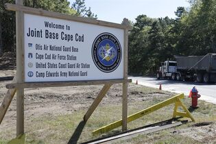 A truck drives past a welcome sign to Joint Base Cape Cod, Monday, Sept. 22, 2014, in Sandwich, Mass. Police and military officials have been searching for three soldiers from the Afghanistan National Army who went missing during a training exercise at the base. (AP Photo/Steven Senne)