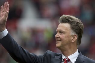 Manchester United's new manager Louis van Gaal waves to supporters before his team's English Premier League soccer match against Swansea City at Old Trafford Stadium, Manchester, England, Saturday Aug. 16, 2014. (AP Photo/Jon Super)