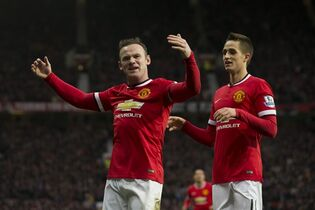 Manchester United's Wayne Rooney, left, celebrates with teammate Adnan Januzaj after scoring his second goal during the English Premier League soccer match between Manchester United and Sunderland at Old Trafford Stadium, Manchester, England, Saturday Feb. 28, 2015. (AP Photo/Jon Super)