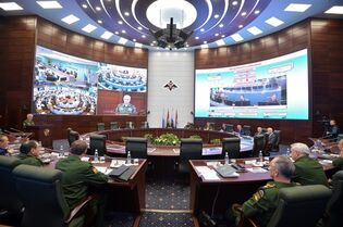 Russian President Vladimir Putin, background center, with Defense Minister Sergei Shoigu, right from Putin, head a meeting with senior military officials in the Defense Ministry's control room in Moscow, Russia on Friday, Dec. 19, 2014. (AP Photo/RIA Novosti, Alexei Druzhinin, Presidential Press Service)