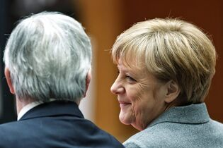 German Chancellor Angela Merkel, right, and President of the European Commission Jean-Claude Juncker attend a conference on innovation and competitiveness hosted by the European Investment Bank in Berlin, Germany, Monday, March 2, 2015. (AP Photo/Markus Schreiber)