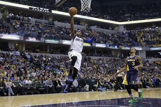 Dallas Mavericks guard Rajon Rondo (9) shots in front of Indiana Pacers guard George Hill (3) during the first half of an NBA basketball game in Indianapolis, Sunday, March 29, 2015. (AP Photo/AJ Mast)