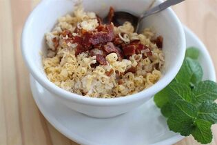 This March 2, 2015 photo shows bacon gouda oatmeal in Concord, N.H. (AP Photo/Matthew Mead)
