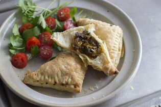 This July 28, 2014 photo shows easy mushroom and sweet potato turnovers in Concord, N.H. These earthy, hearty turnovers work equally well as a fall gathering appetizer and an easy weeknight meal. (AP Photo/Matthew Mead)