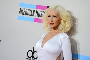 FILE - In this Nov. 24, 2013, file photo, Christina Aguilera arrives at the American Music Awards at the Nokia Theatre L.A. Live, in Los Angeles. The NBA announced Tuesday, Jan. 27, 2015, that Aguilera will perform ahead of the 64th annual NBA All-Star Game on Feb. 15 at Madison Square Garden in New York City. She will sing a