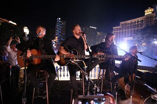 """FILE - In this Saturday, Nov. 8, 2014, file photo, Imagine Dragons perform during the Crackle's """"Playing It Forward"""" at the Bellagio in Las Vegas. The Grammy-winning band Imagine Dragons and Southwest Airlines announced Monday, Jan. 26, 2015, that the group will perform a surprise Live at 35 concert at 35,000 feet on a Feb. 24 flight. (Photo by Omar Vega/Invision/AP, File)"""