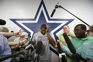 FILE - In this Sept. 3, 2014, file photo, Dallas Cowboys practice squad player defensive end Michael Sam arrives to speak to reporters after practice at the team's headquarters in Irving, Texas. The Cowboys have released Michael Sam from the practice squad, Tuesday, Oct. 21, 2014, another setback as the NFL's first openly gay player tries to make an active roster during the regular season for the first time.(AP Photo/LM Otero, File)