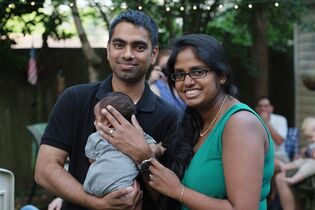 "In this Saturday, Aug. 16, 2014 photo provided by Wasim Ahmad, Ahmad, left, and his wife, Lakshmi Ramsoondar-Ahmad, pose with their newborn son in Merrick, N.Y. Two days after his son was born, Ahmad bought the website domain with his son's name. ""I'm going to make it a private website with a password so family can log in"" to see updates, he says. ""When he gets old enough, I'll probably give him the keys.""(AP Photo/Courtesy Wasim Ahmad, Scott Stamile)"