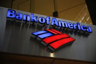 FILE - This Tuesday, Jan. 14, 2014 file photo shows a Bank of America sign in Philadelphia. Officials familiar with the deal say Bank of America on Wednesday, Aug. 20, 2014 has reached a record $17 billion settlement with federal and state authorities over its role in the sale of mortgage-backed securities in the run-up to the 2008 financial crisis. (AP Photo/Matt Rourke, File)
