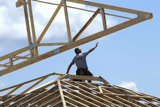 In this July 17, 2014 photo, construction workers build a commercial complex in Springfield, Ill. The Conference Board reports on its August index of leading economic indicators, which is designed to predict the economy's future health, on Friday, Sept. 19, 2014. (AP Photo/Seth Perlman)