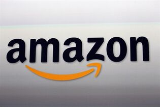 This Sept. 6, 2012 photo shows an Amazon logo at the introduction of the new Amazon Kindle Fire HD and Kindle Paperwhite personal devices, in Santa Monica, Calif. Amazon will report earnings Thursday April 23, 2015. (AP Photo/Reed Saxon)
