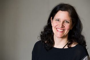 """FILE - In this April 16, 2014 file photo, Laura Poitras poses for a portrait in New York. The Film Society of Lincoln Center announced Tuesday, Sept. 16, that Laura Poitras's """"Citizenfour"""" will premiere October 10 as part of the annual New York Film Festival. """"Citizenfour"""" opens in theaters October 24. (Photo by Charles Sykes/Invision/AP, File)"""